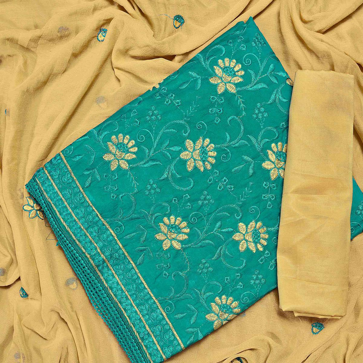 Appealing Turquoise Green Colored Partywear Embroidered Chanderi Silk Dress Material