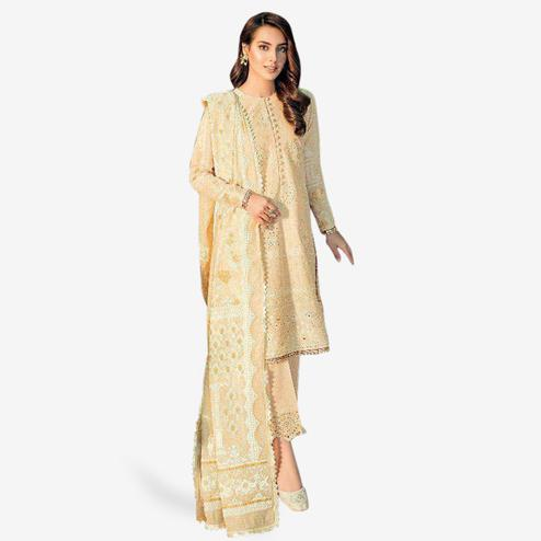 Prominent Beige Colored Partywear Embroidered Cotton Suit