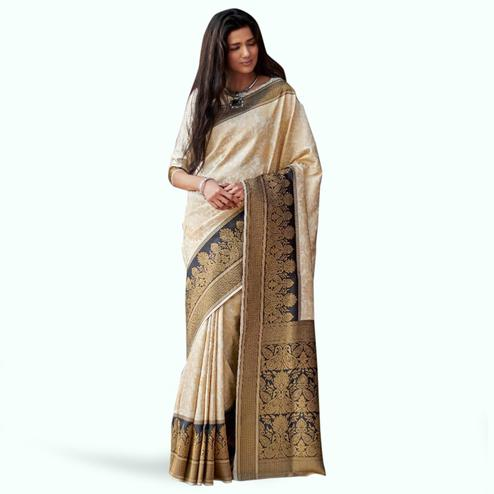 Adorning Pearl Cream Colored Festive Wear Woven Silk Saree