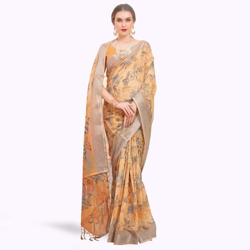 Trendy Pastel Orange Colored Casual Printed Linen Saree