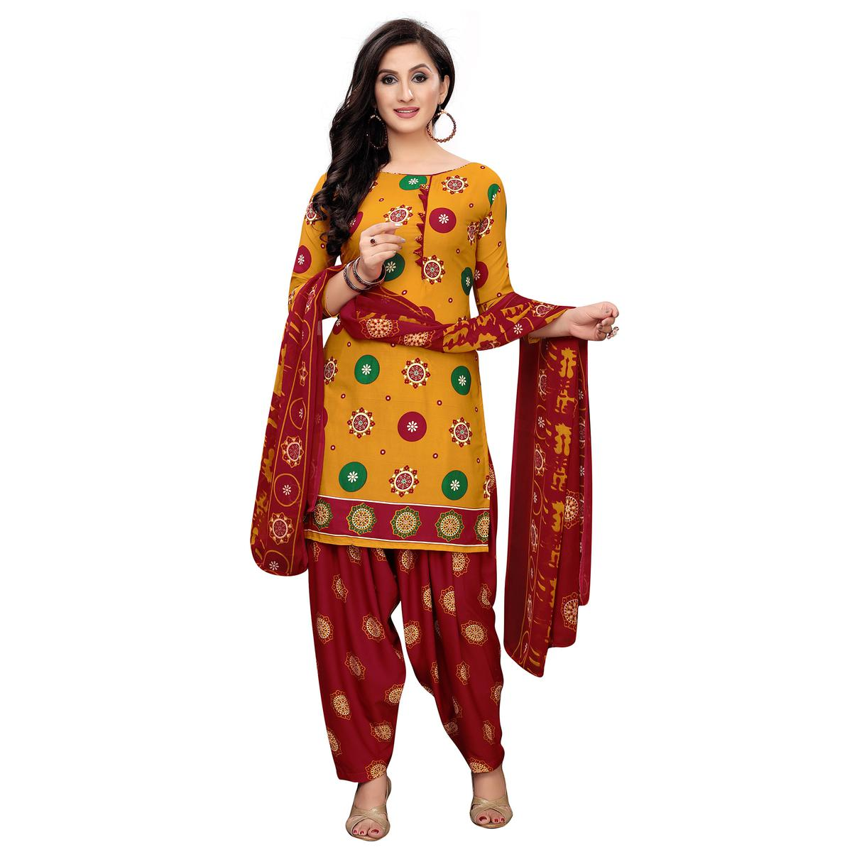 Imposing Yellow Colored Casual Printed Crepe Patiala Dress Material