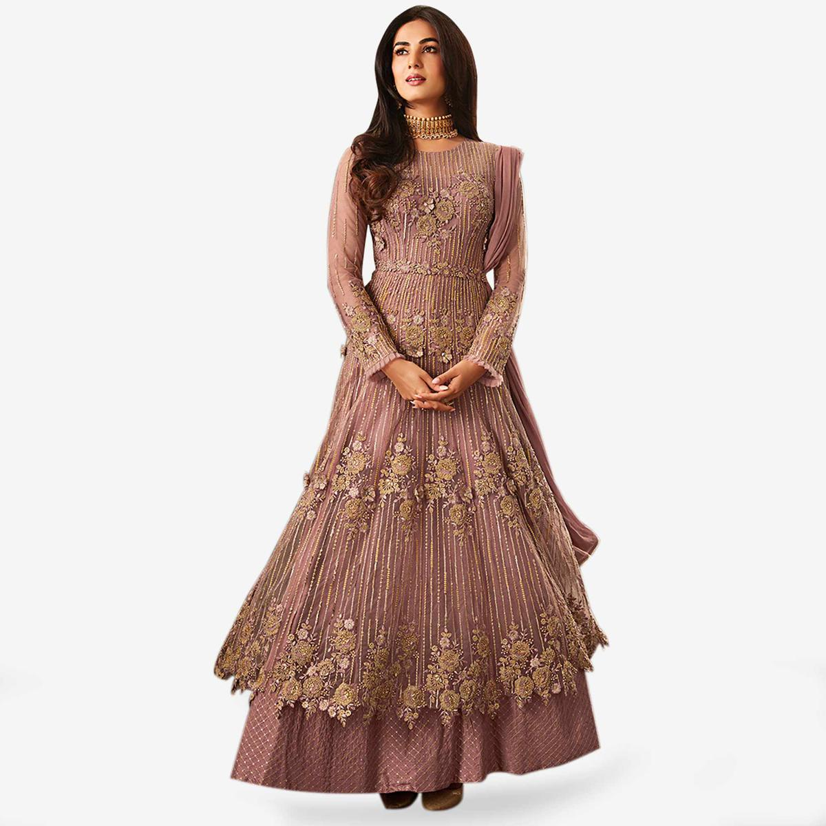 Hypnotic Mauve Colored Partywear Embroidered Netted Anarkali Suit