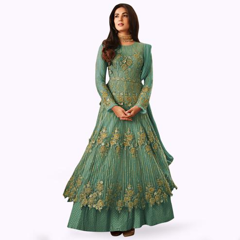 Gleaming Sky Blue Colored Partywear Embroidered Netted Anarkali Suit