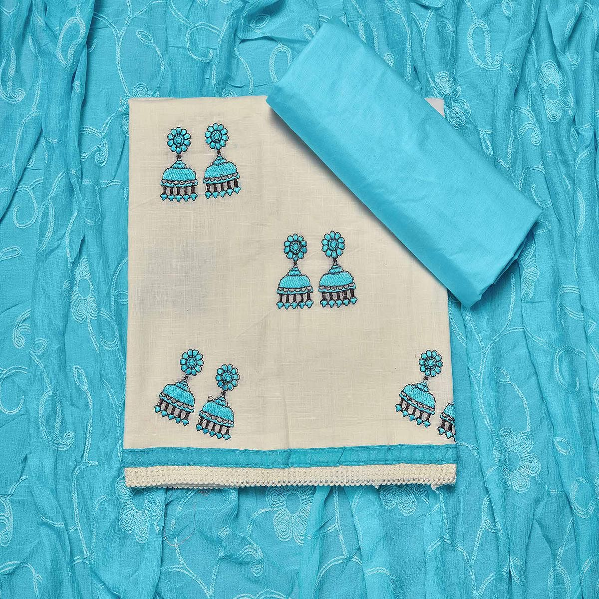 Adorning White-Sky Blue Colored Partywear Embroidered Cotton Dress Material