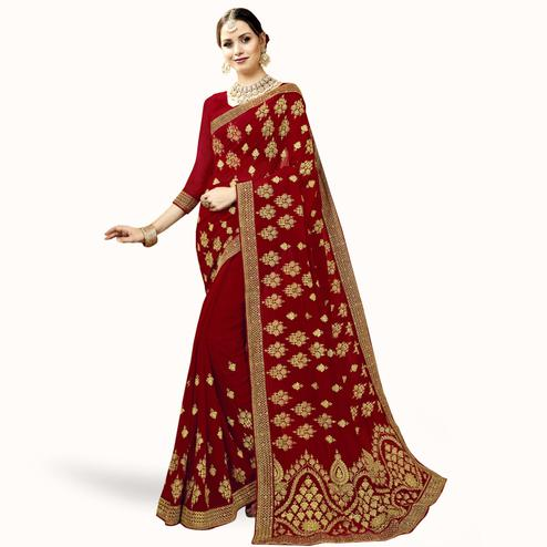 Desirable Maroon Colored Partywear Embroidered Georgette Saree