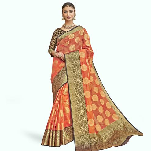 Magnetic Orange Colored Festive Wear Woven Tissue Saree