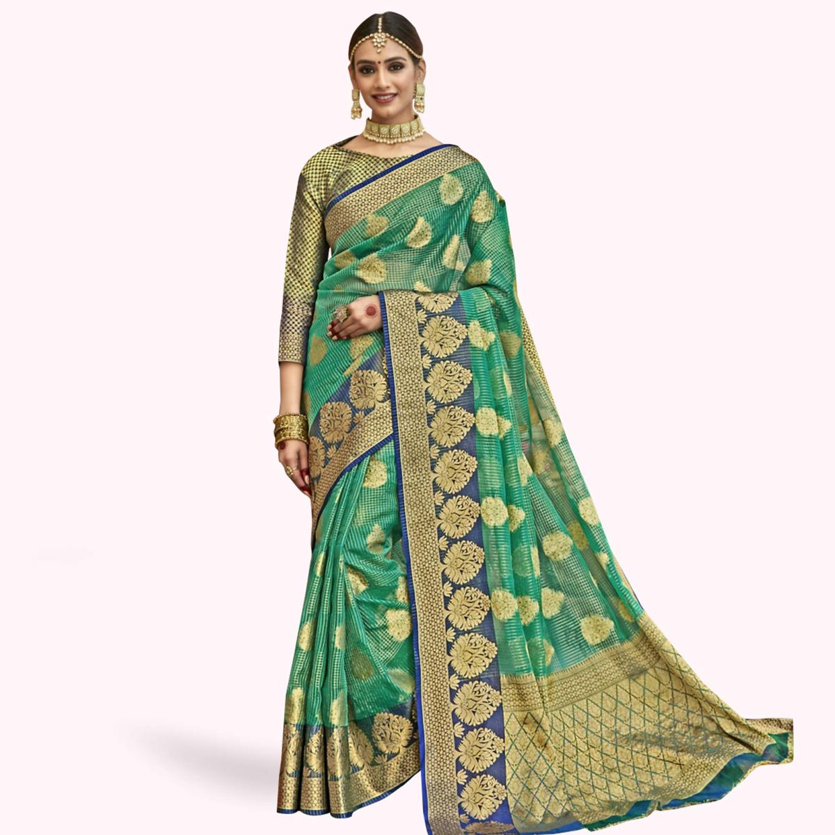 Refreshing Green Colored Festive Wear Woven Tissue Saree