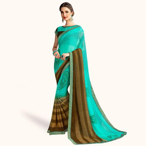 Unique Aqua Green Colored Casual Printed Georgette Saree