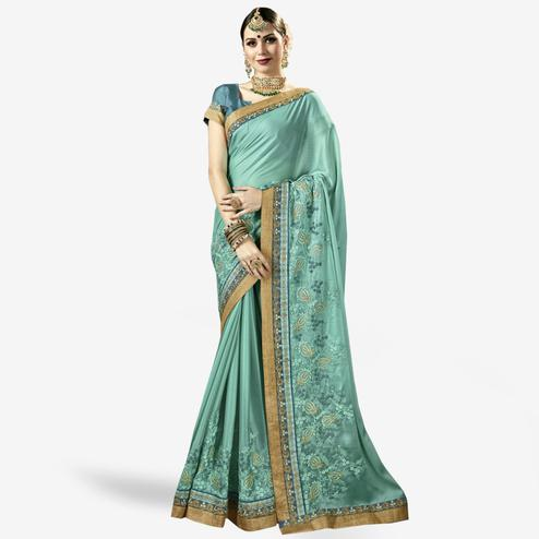 Graceful Pastel Aqua Blue Colored Partywear Embroidered Art Silk Saree