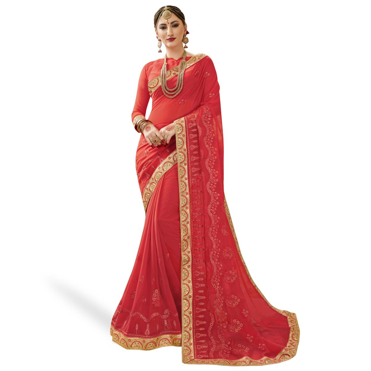 Flaunt Coral Red Colored Partywear Embroidered Georgette Saree