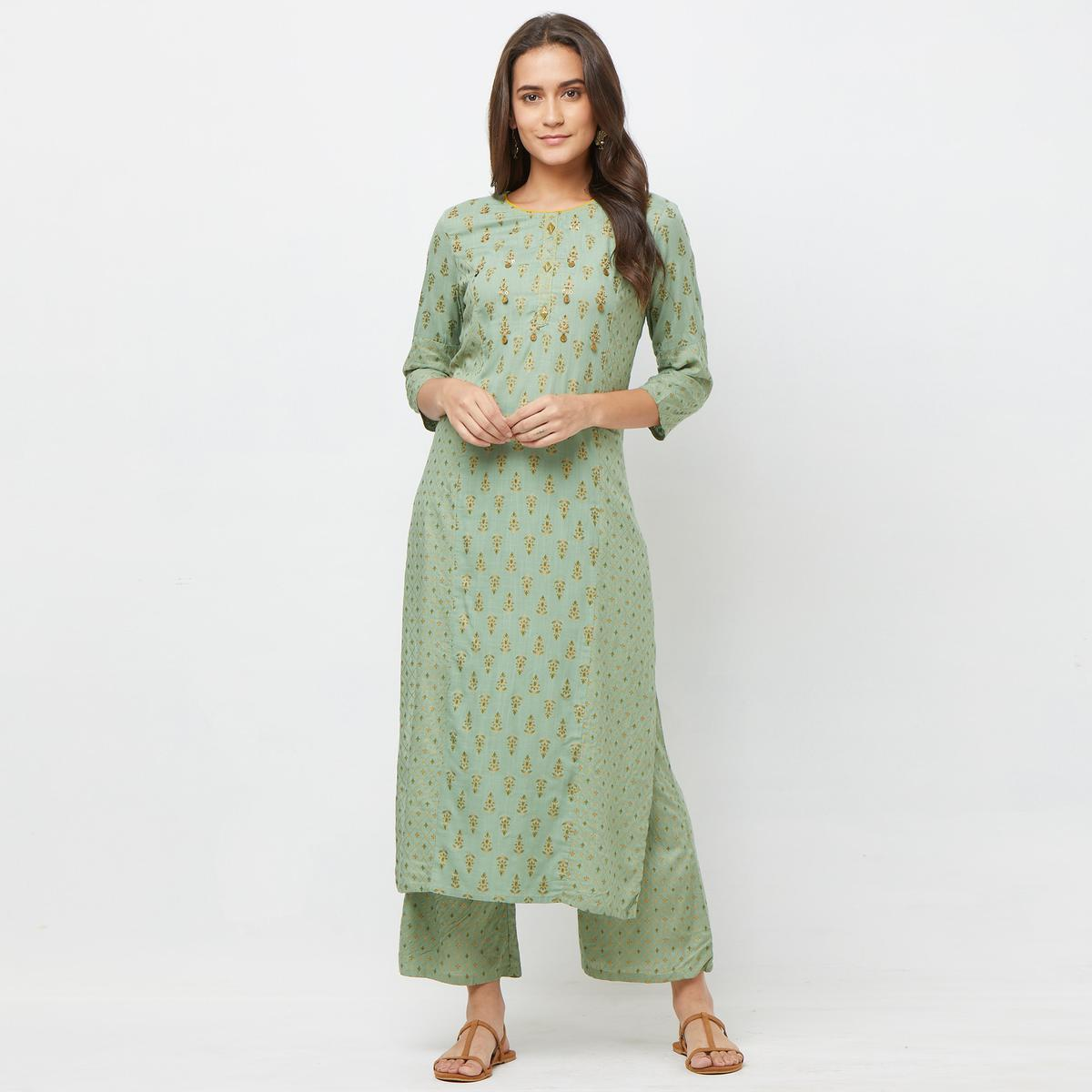 Capricious Pastel Green Colored Partywear Embroidered Cotton Kurti-Palazzo Set