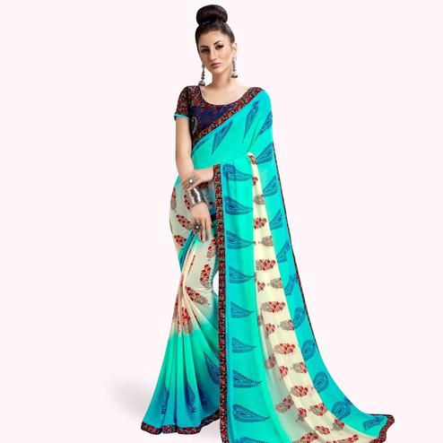 Demanding Aqua Blue Colored Casual Printed Georgette Saree