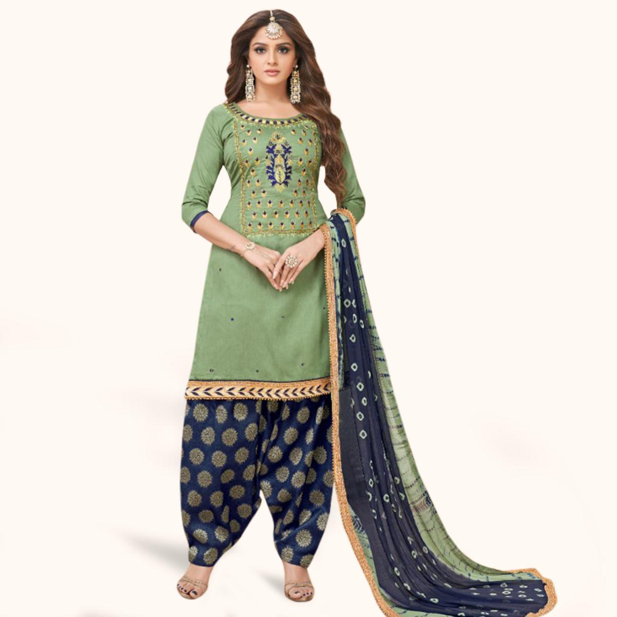 Magnetic Green Colored Partywear Embroidered Cotton Patiala Suit
