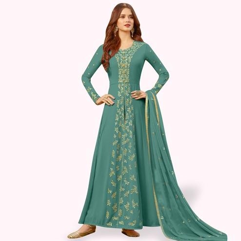 Delightful Turquoise Green Colored Partywear Embroidered Georgette Anarkali Suit