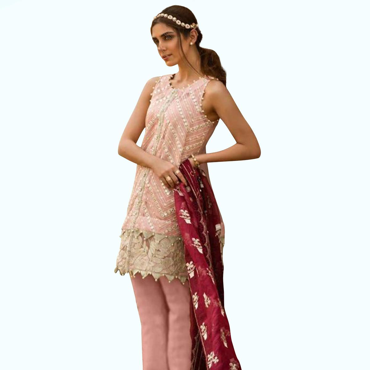 Entrancing Pastel Peach Colored Partywear Embroidered Organza Suit