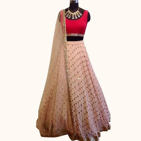 Exotic Peach Colored Partywear Georgette Lehenga Choli