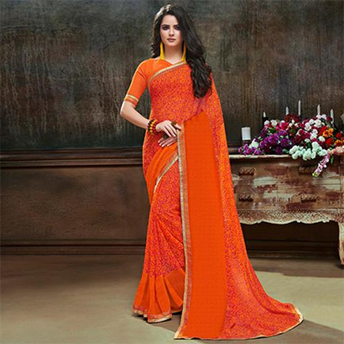 Trendy Orange Georgette Printed Saree