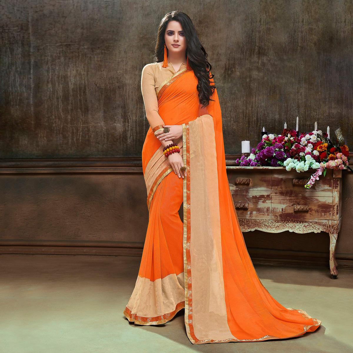 Charming Orange Georgette Printed Saree