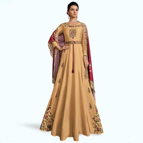 Mesmeric Beige Colored Partywear Embroidered Silk Abaya Style Anarkali Suit