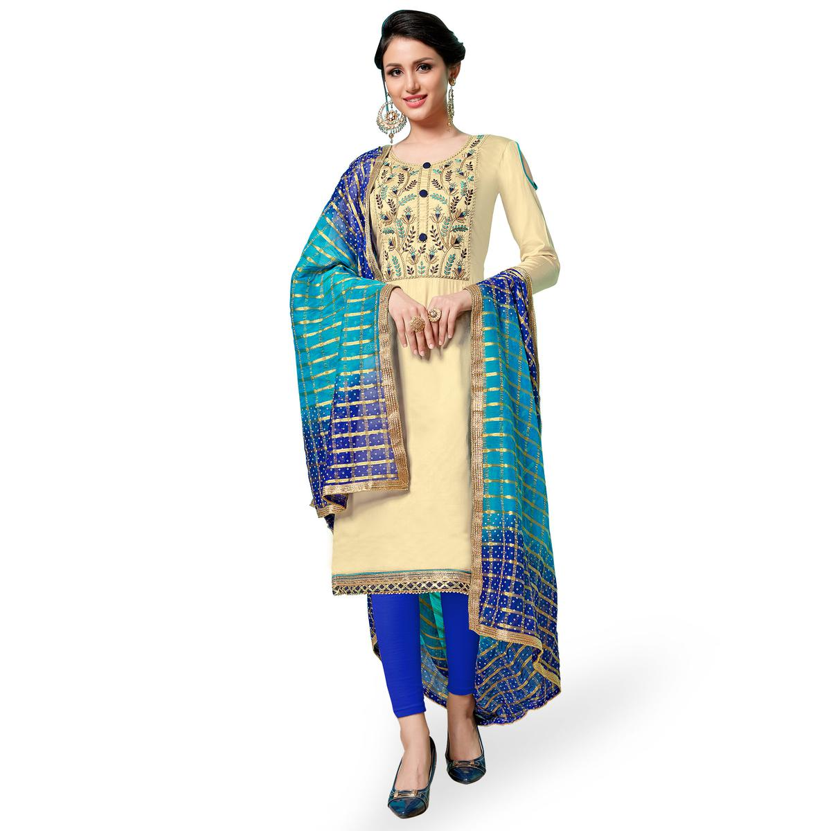 Beautiful Beige Colored Partywear Embroidered Cotton Dress Material