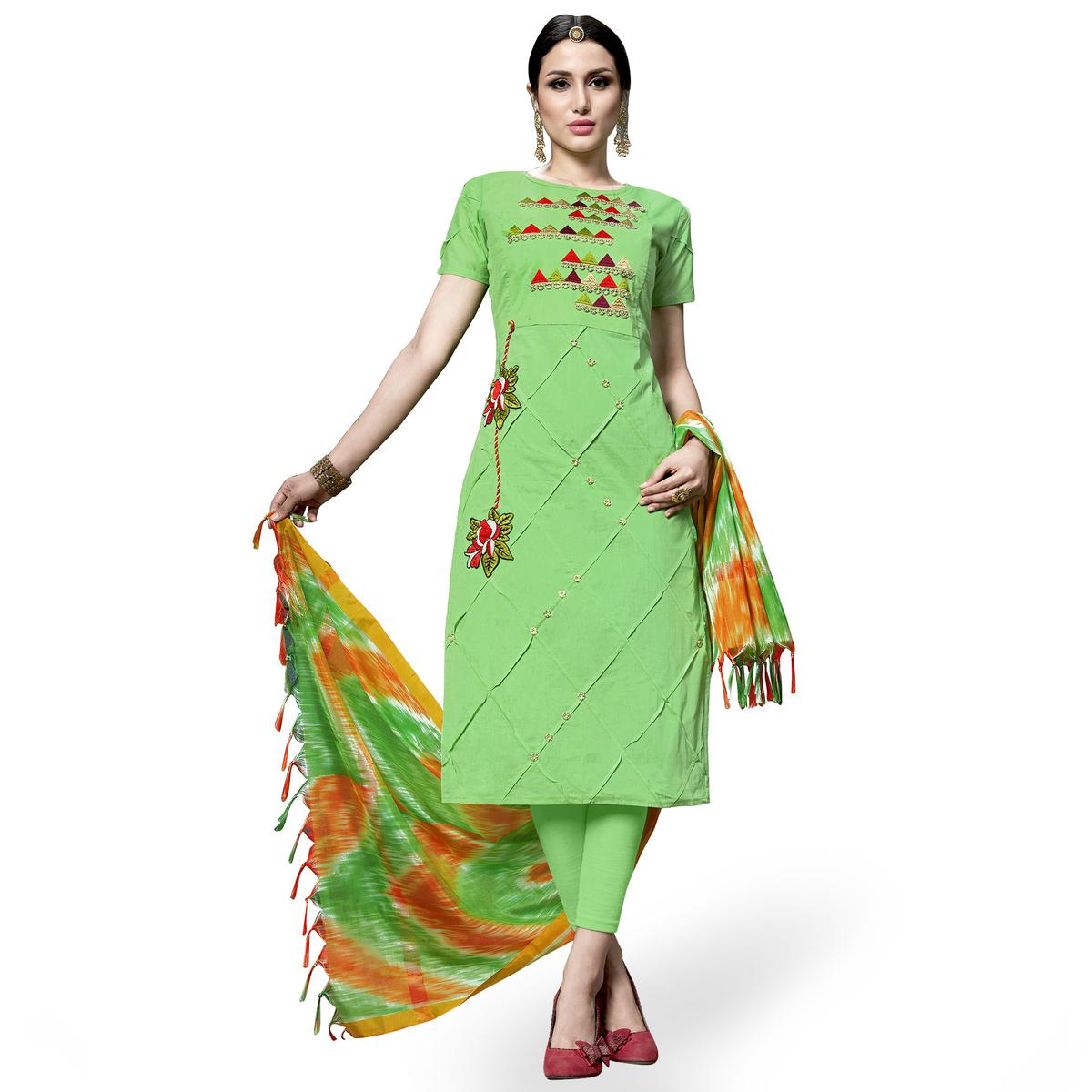 Unique Green Colored Partywear Embroidered Cotton Dress Material