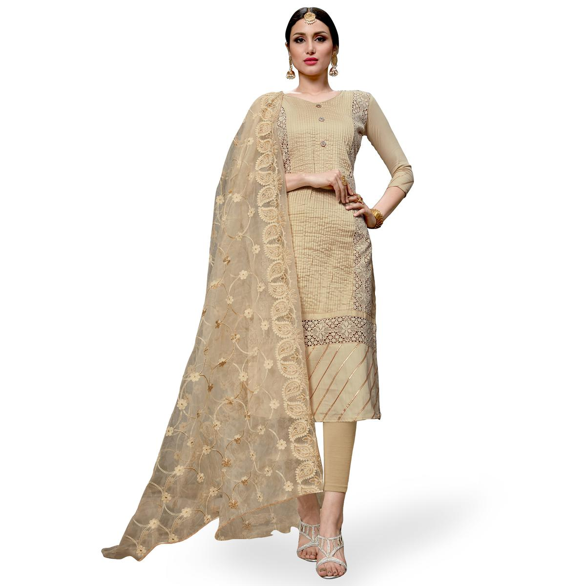 Demanding Cream Colored Partywear Embroidered Cotton Dress Material
