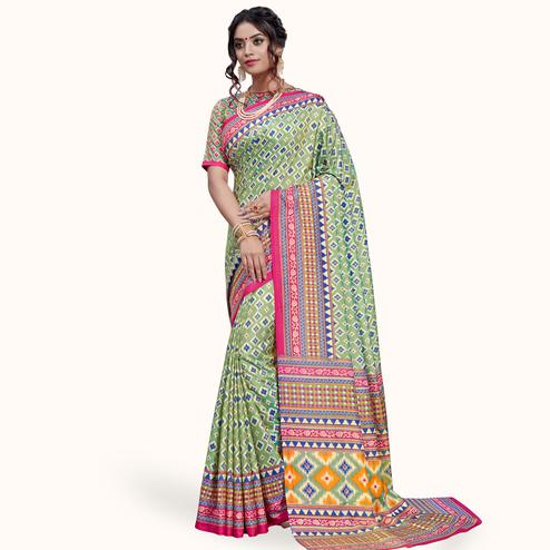 Breathtaking Pastel Green Colored Casual Printed Art Silk Saree