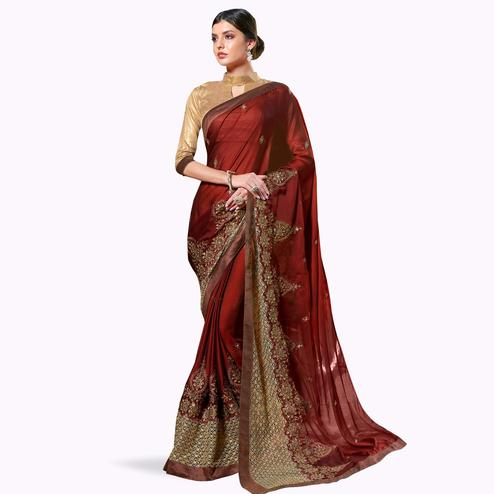Ravishing Maroon Colored Partywear Embroidered Georgette Saree