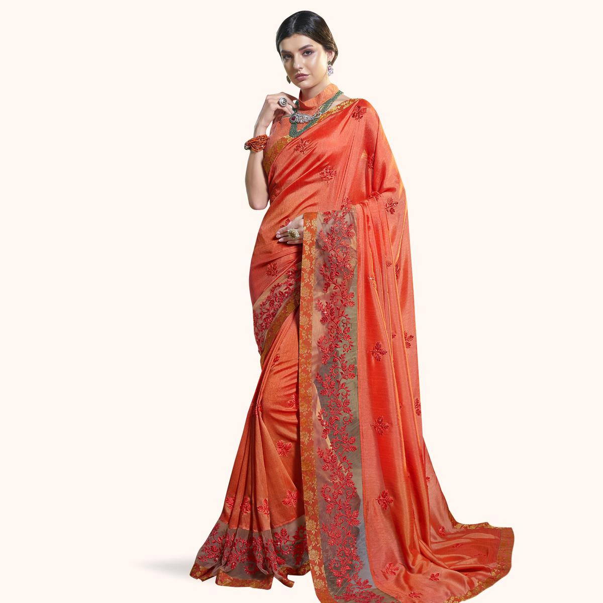 Staring Orange Colored Partywear Embroidered Georgette Saree