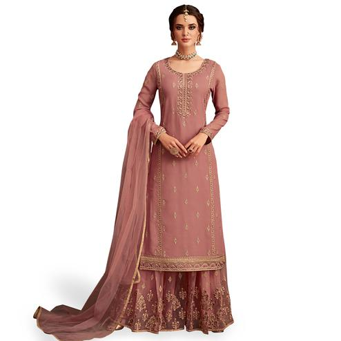 Capricious Pastel Red Colored Partywear Embroidered Faux Georgette Palazzo Suit