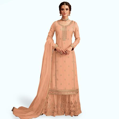 Entrancing Salmon Colored Partywear Embroidered Faux Georgette Palazzo Suit