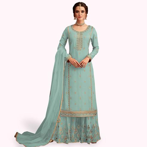 Groovy Pastel Blue Colored Partywear Embroidered Faux Georgette Palazzo Suit