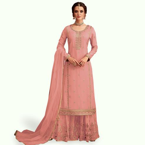 Prominent Pink Colored Partywear Embroidered Faux Georgette Palazzo Suit