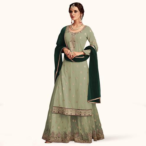 Flaunt Mint Green Colored Partywear Embroidered Faux Georgette Palazzo Suit