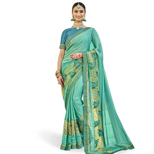 Mesmerising Turquoise Green Colored Partywear Embroidered Georgette Saree