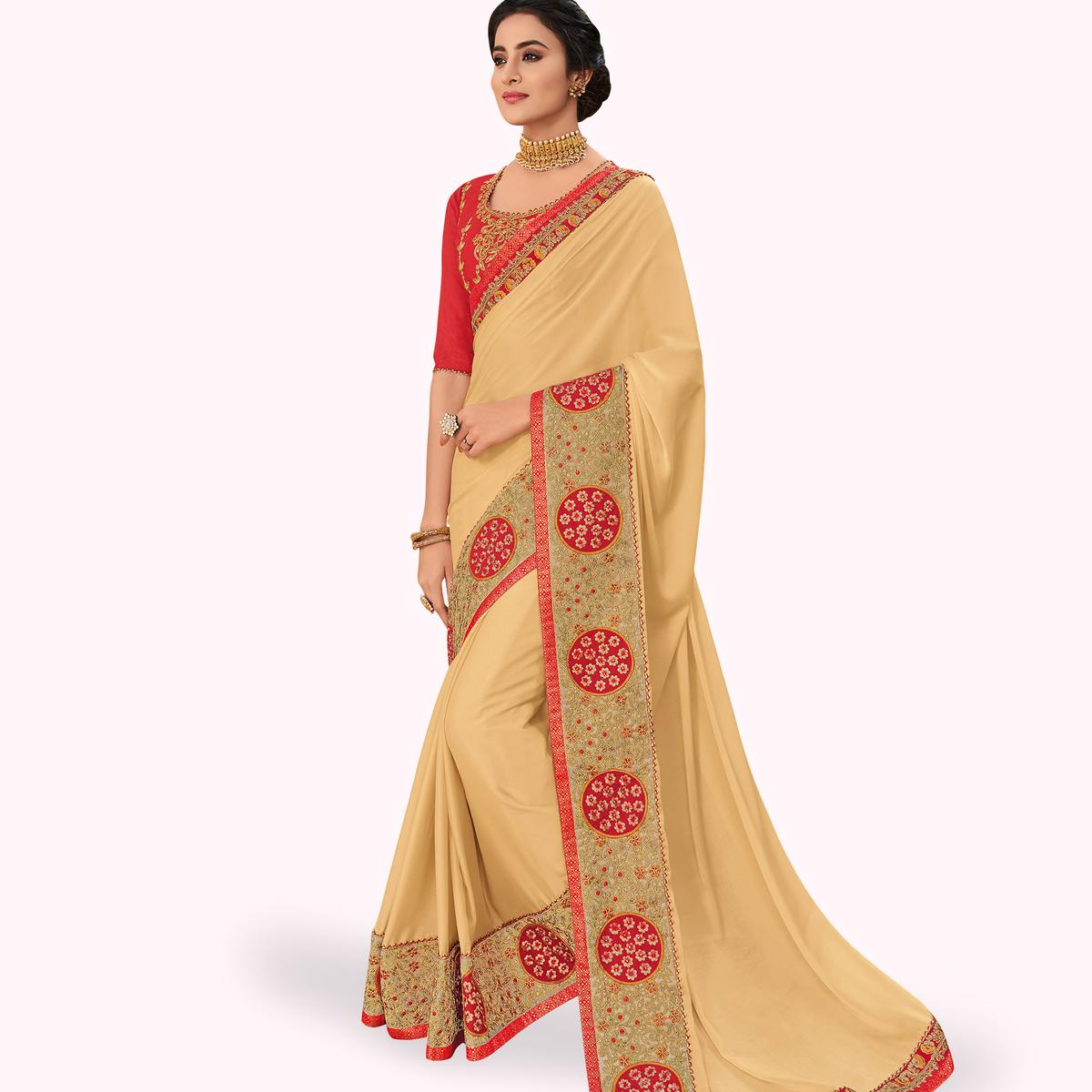 Elegant Beige Colored Partywear Embroidered Georgette Saree