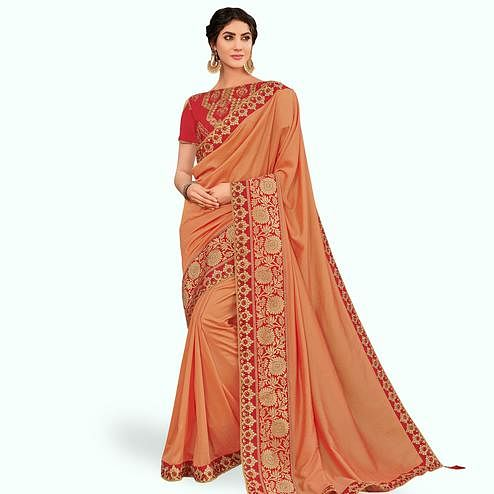 Opulent Peach Colored Partywear Embroidered Raw Silk Saree