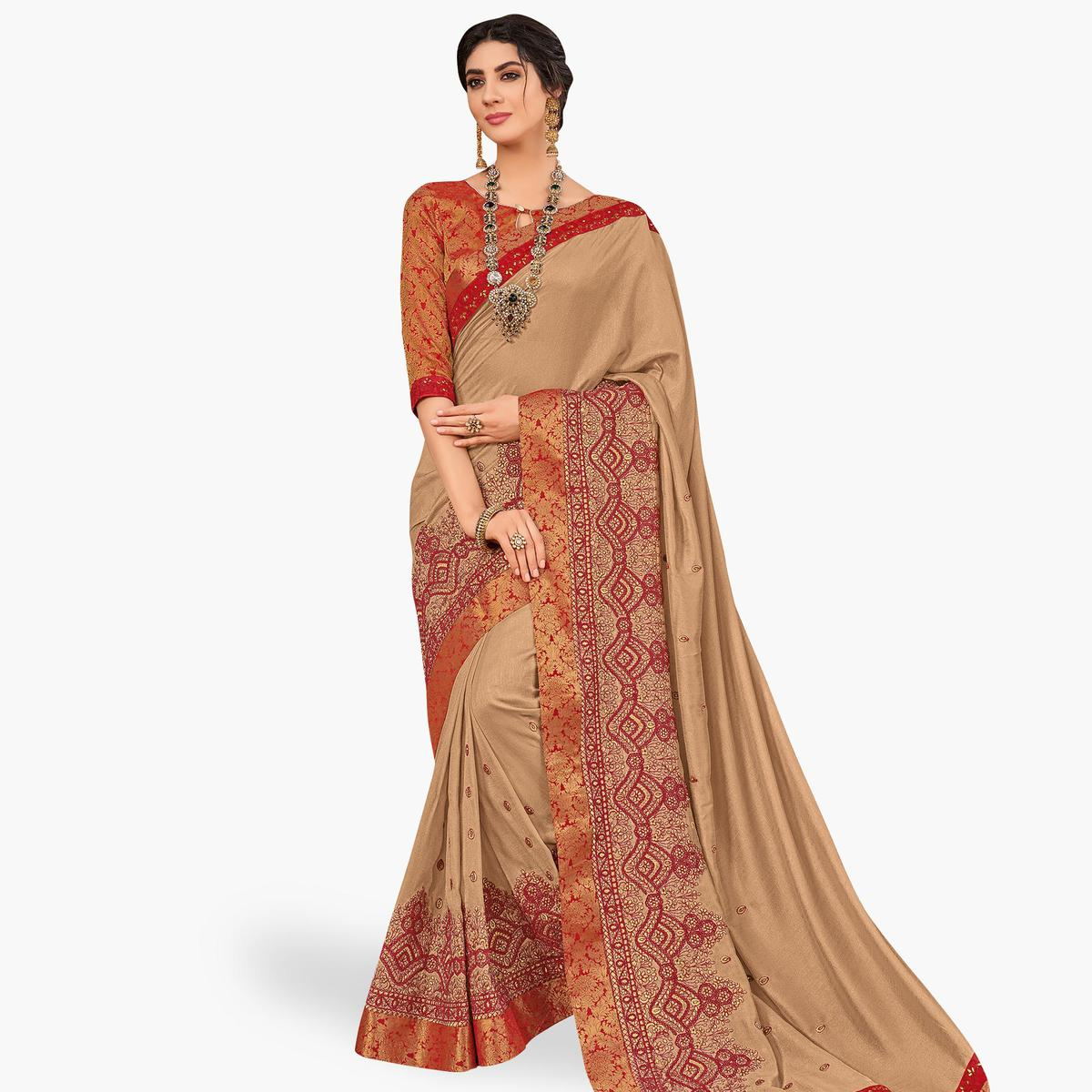 Gleaming Beige Colored Partywear Embroidered Silk Saree