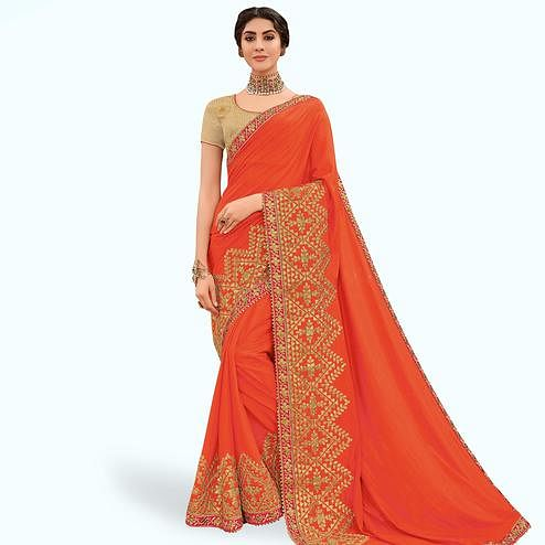 Magnetic Orange Colored Partywear Embroidered Raw Silk Saree
