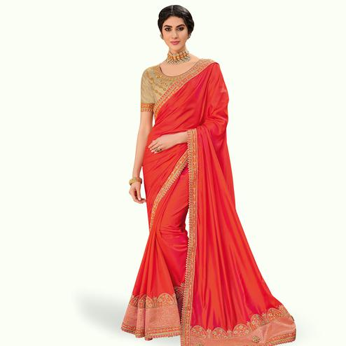 Hypnotic Orange Colored Partywear Embroidered Raw Silk Saree