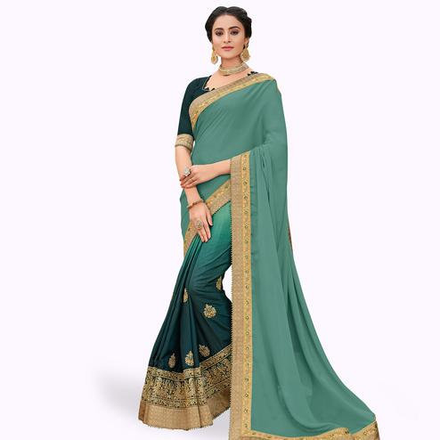 Arresting Pastel Teal Green Colored Partywear Embroidered Silk Saree