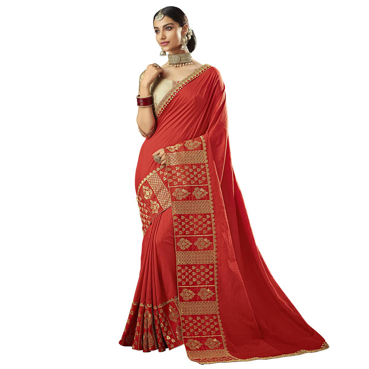 Adorable Red Colored Partywear Embroidered Raw Silk Saree