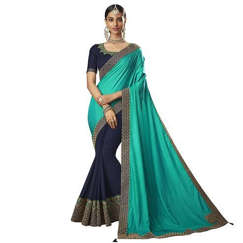 Glorious Turquoise Green-Navy Blue Colored Partywear Embroidered Raw Silk Saree