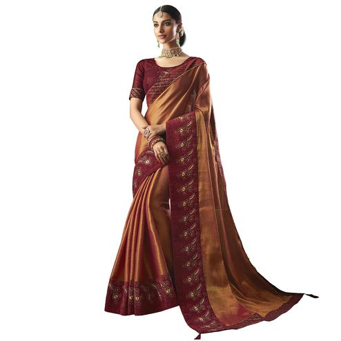 Engrossing Orange Colored Partywear Embroidered Art Silk Saree