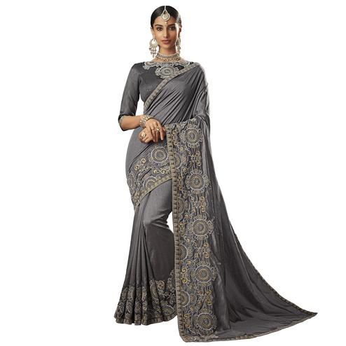 Innovative Gray Colored Partywear Embroidered Raw Silk Saree