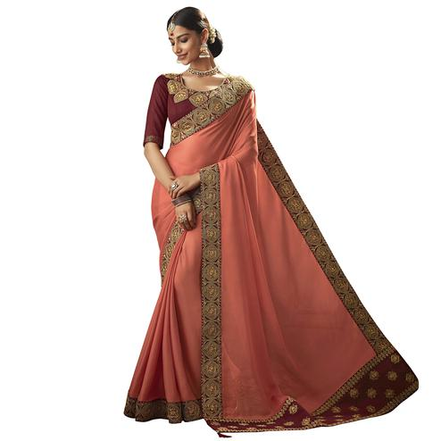 Eye-catching Peach Colored Partywear Embroidered Georgette Saree