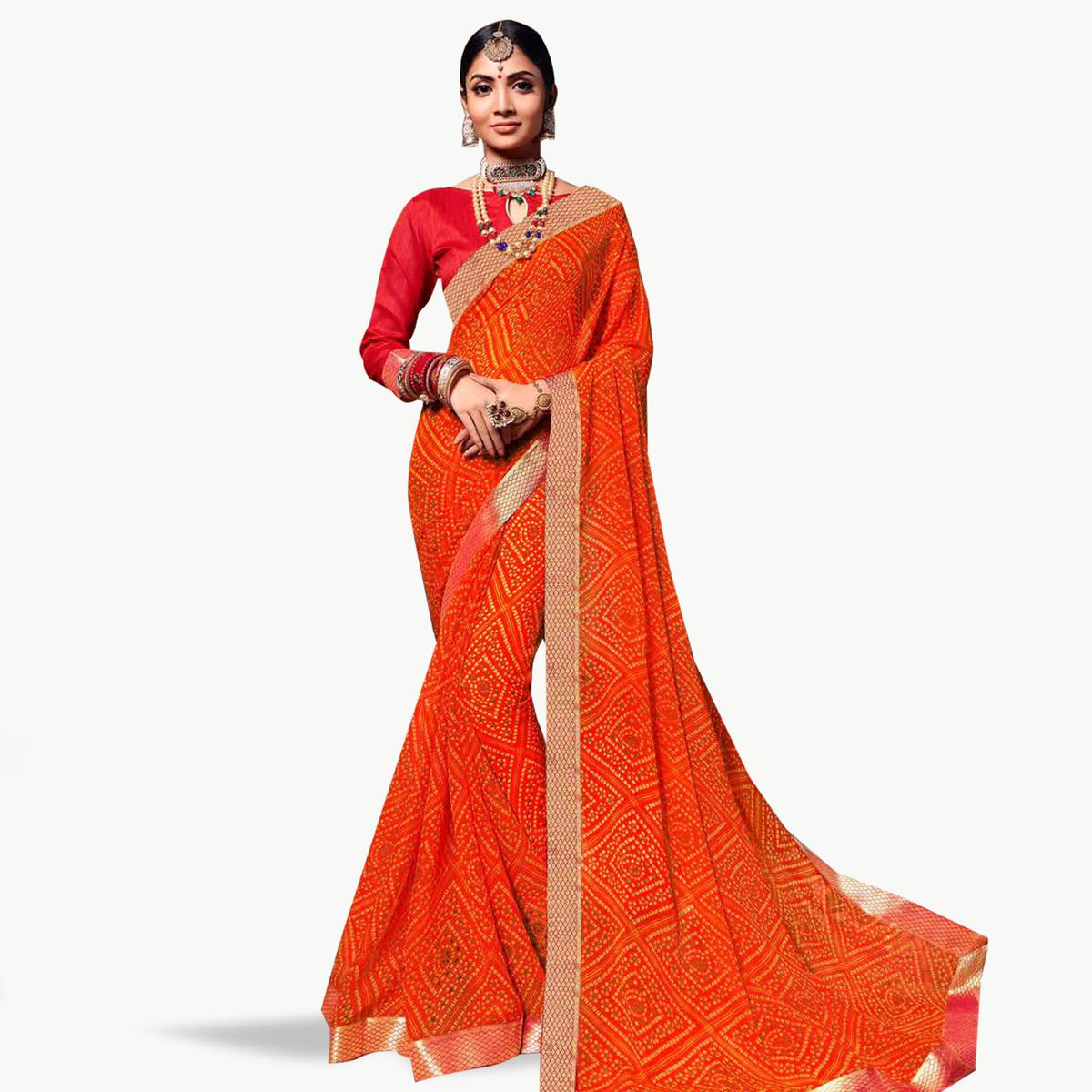 Fantastic Orange Colored Bandhani Printed Heavy Georgette Saree With Jacquard Lace Border