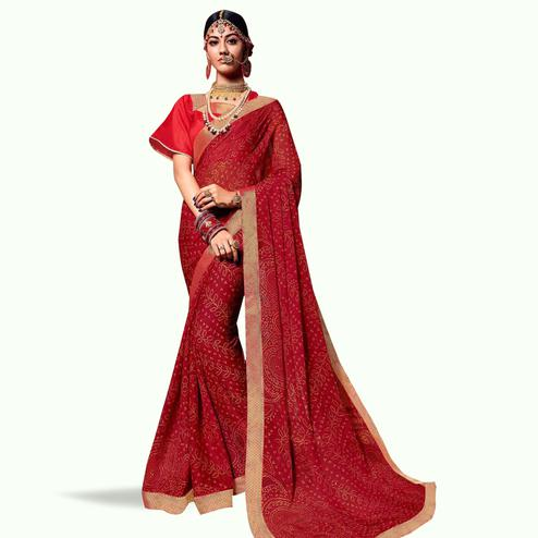 Blissful Red Colored Bandhani Printed Heavy Georgette Saree With Jacquard Lace Border