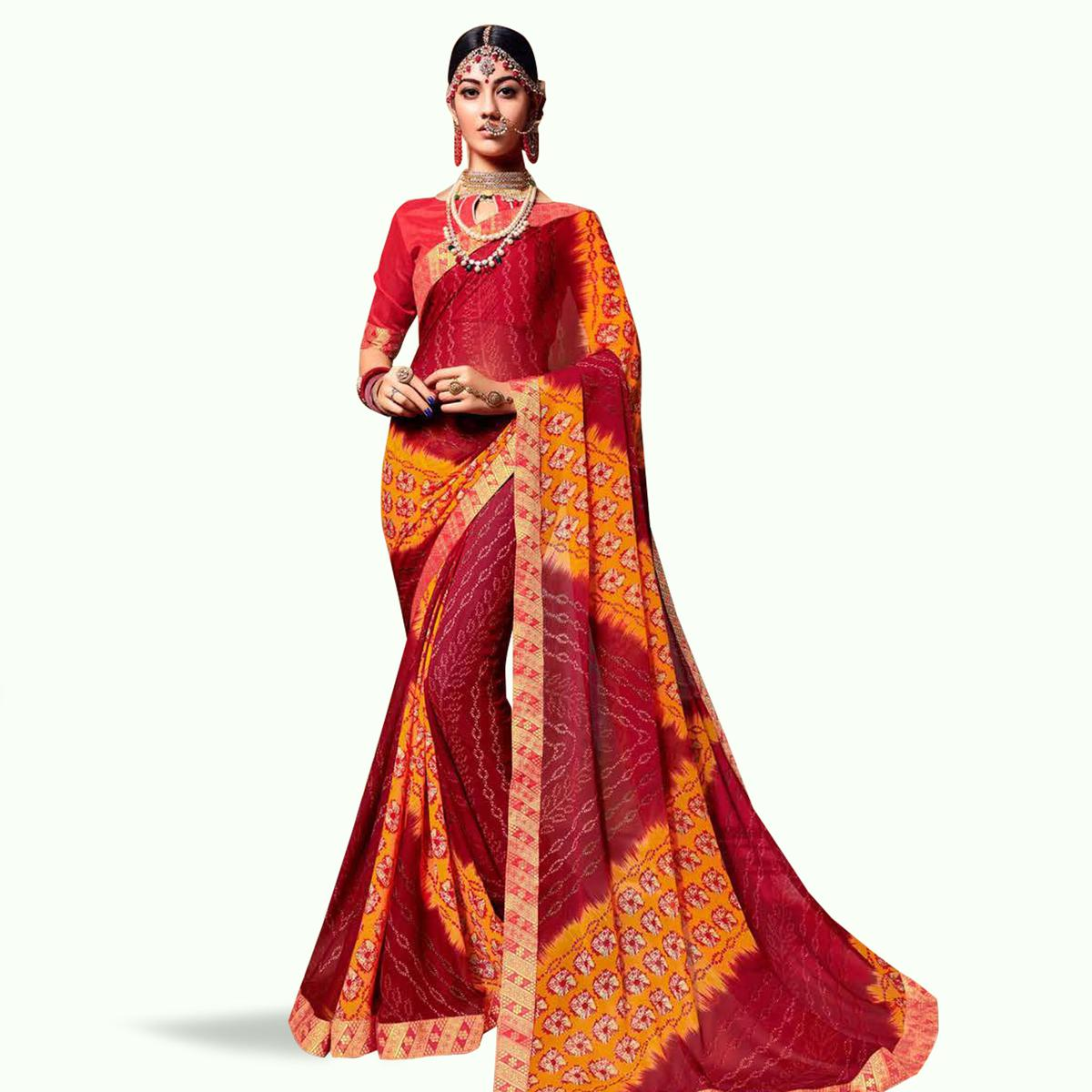 Majesty Red-Yellow Colored Bandhani Printed Heavy Georgette Saree With Jacquard Lace Border