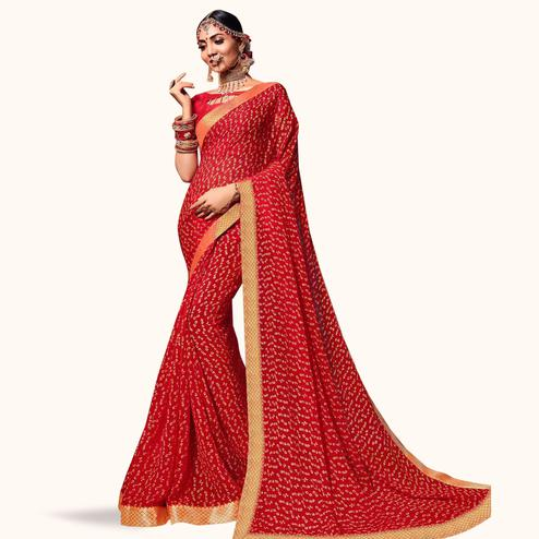Mesmerising Red Colored Bandhani Printed Heavy Georgette Saree With Jacquard Lace Border